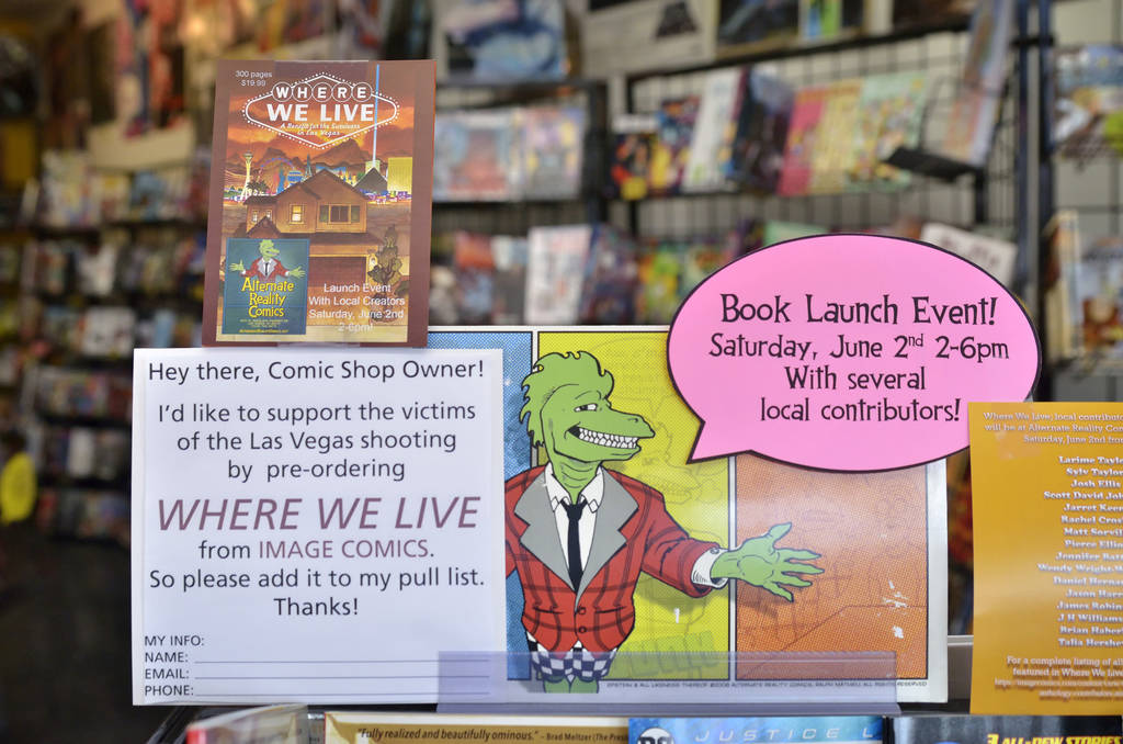 A sign is shown during a book launch and signing for ÒWhere We Live,Ó a comic book book anthology dealing with the Route 91 Harvest Festival shooting, at Alternate Reality Comics at 4110 ...