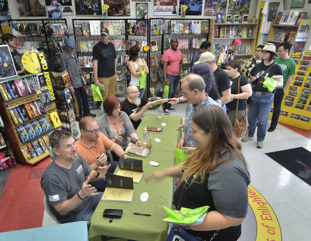 Contributors and customers are shown during a book launch and signing for ÒWhere We Live,Ó a comic book anthology dealing with the Route 91 Harvest Festival shooting, at Alternate Realit ...