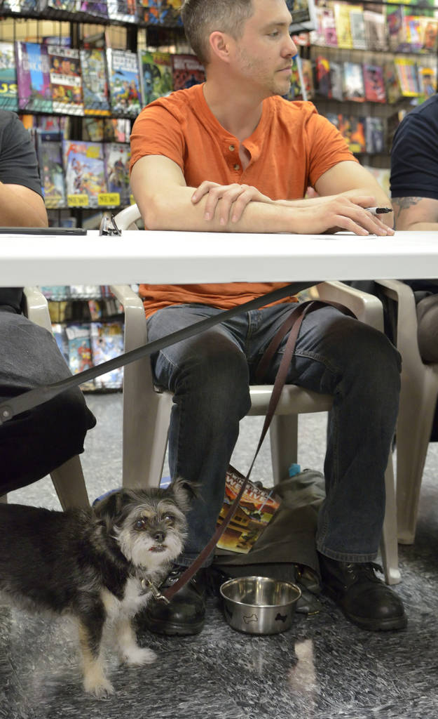 Matt Sorvillo is shown with his dog Hero during a book launch and signing for ÒWhere We Live,Ó a comic book anthology dealing with the Route 91 Harvest Festival shooting, at Alternate Re ...
