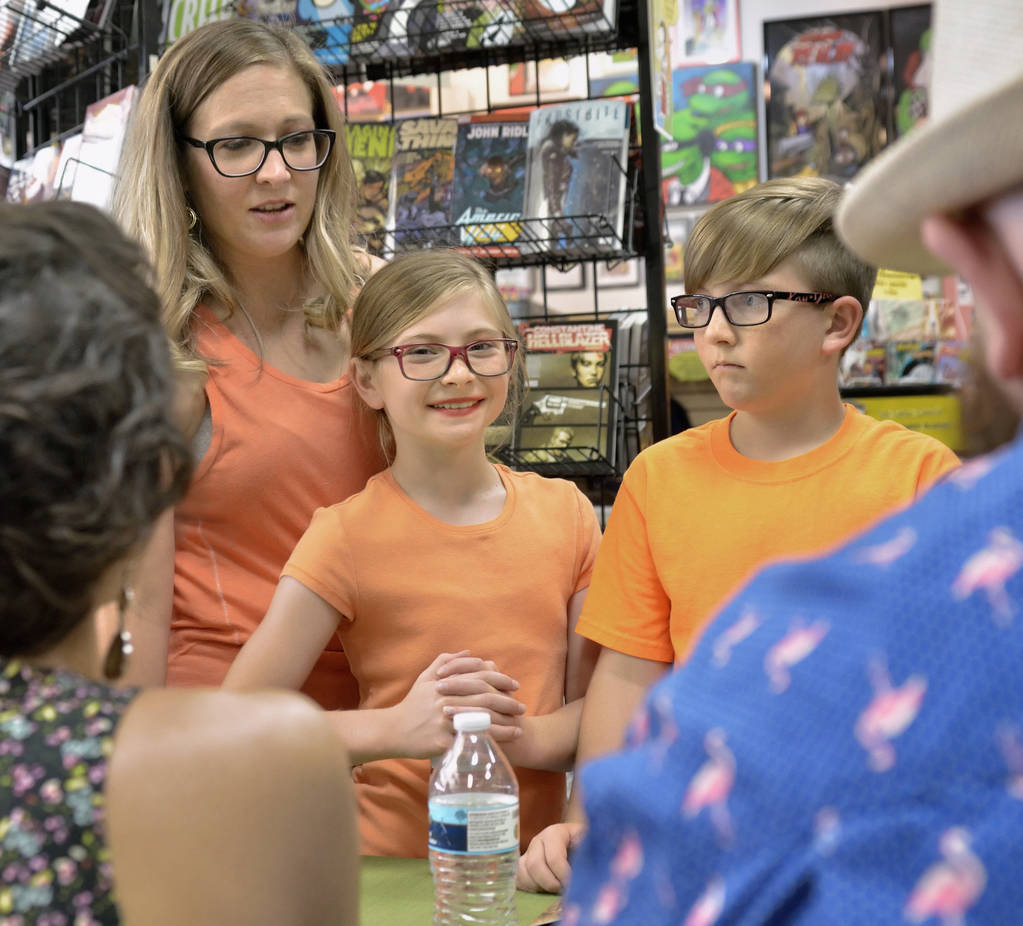 Heather Johnson, left, is shown with her children Magnolia and David during a book launch and signing for ÒWhere We Live,Ó a comic book anthology dealing with the Route 91 Harvest Festiv ...