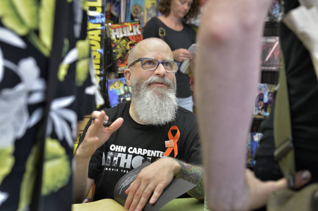 JH Williams III is shown during a book launch and signing for ÒWhere We Live,Ó a comic book anthology dealing with the Route 91 Harvest Festival shooting, at Alternate Reality Comics at ...