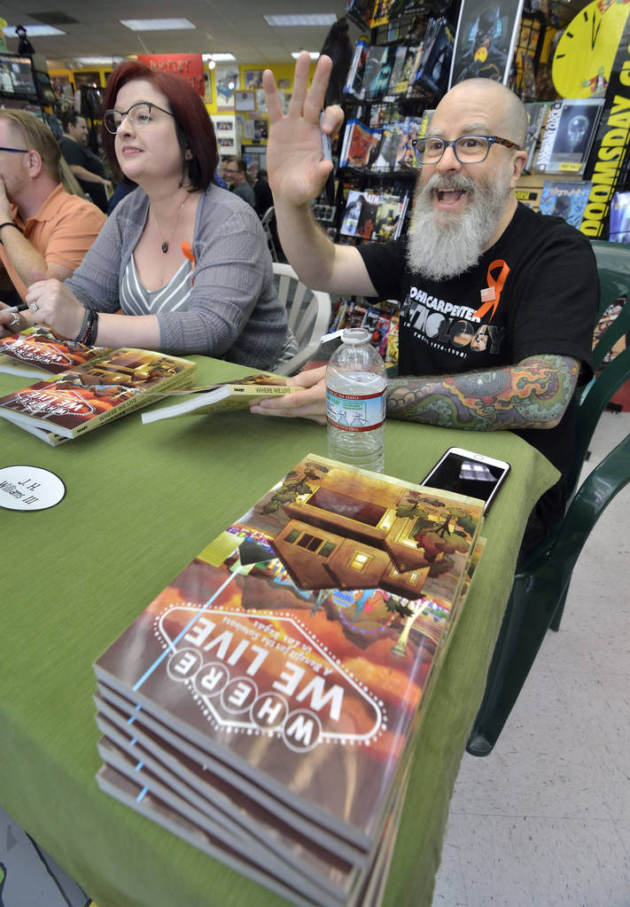 JH Williams III greets a friend as his wife Wendy Wright-Williams looks on during a book launch and signing for ÒWhere We Live,Ó a comic book anthology dealing with the Route 91 Harvest ...