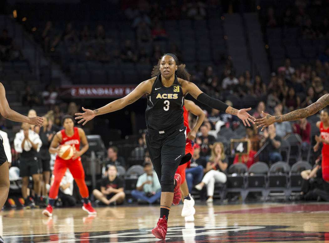 Las Vegas Aces center Kelsey Bone (3) celebrates after making a shot against the Washington Mystics in the first half of a WNBA basketball game at the Mandalay Bay Events Center in Las Vegas on Fr ...