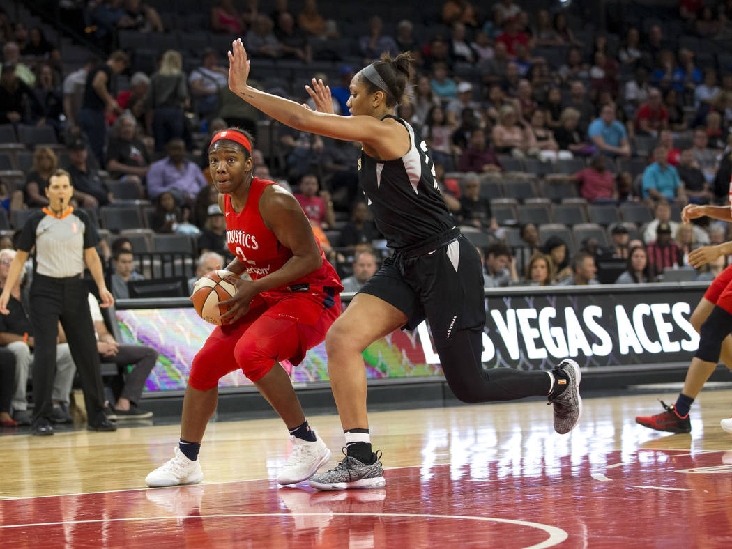 Washington Mystics forward Myisha Hines-Allen (2) looks for a pass through Las Vegas Aces center A'ja Wilson (22) in the first half of a WNBA basketball game at the Mandalay Bay Events Center in L ...