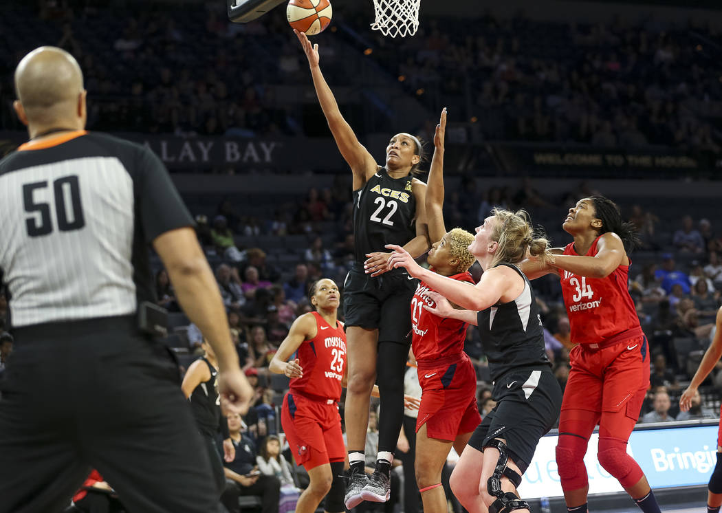 Las Vegas Aces center A'ja Wilson (22) takes a shot over Washington Mystics forward Tianna Hawkins (21) in the second half of a WNBA basketball game at the Mandalay Bay Events Center in Las Vegas ...