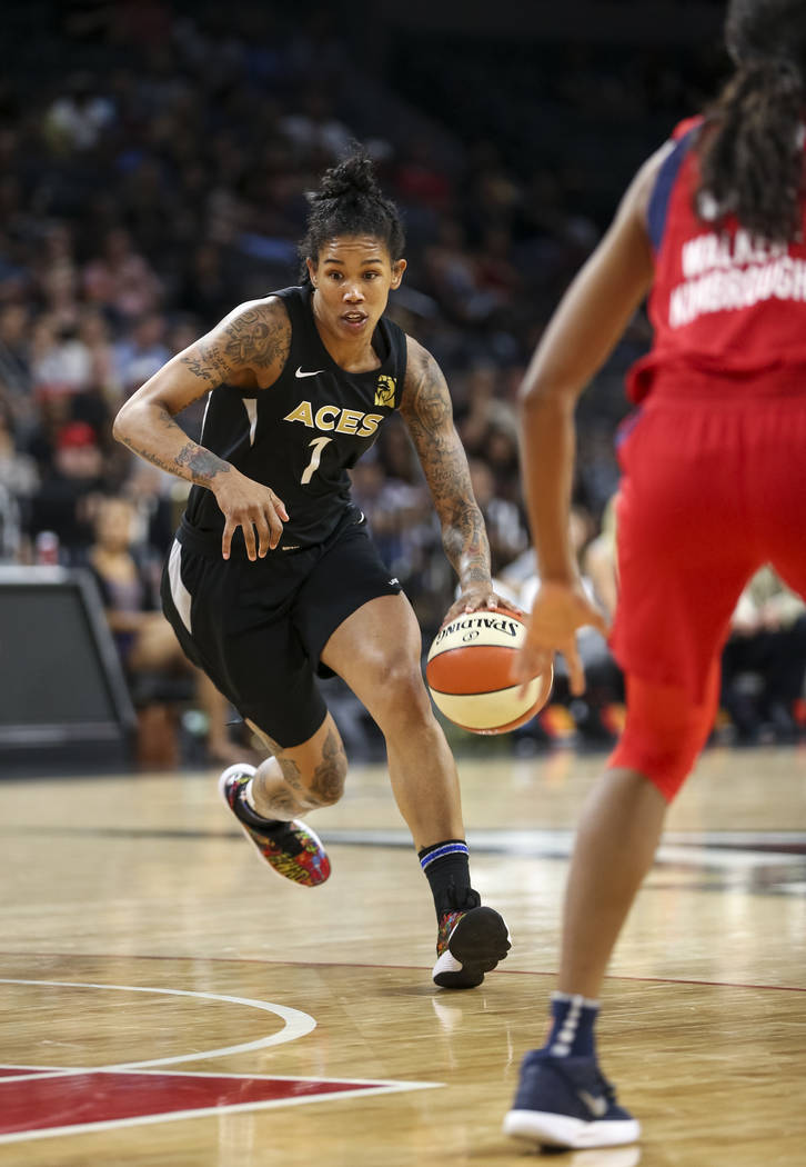 Las Vegas Aces forward Tamera Young (1) dribbles the ball against the Washington Mystics in the second half of a WNBA basketball game at the Mandalay Bay Events Center in Las Vegas on Friday, June ...
