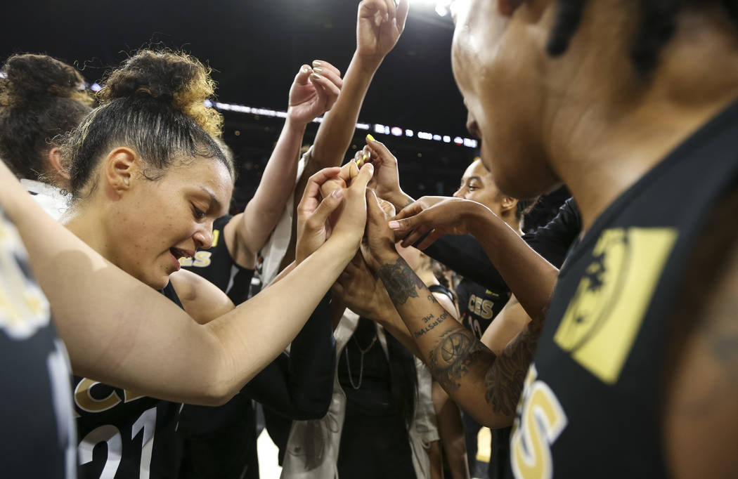 The Las Vegas Aces celebrate their 85-73 victory over the Washington Mystics following a WNBA basketball game at the Mandalay Bay Events Center in Las Vegas on Friday, June 1, 2018. Richard Brian ...