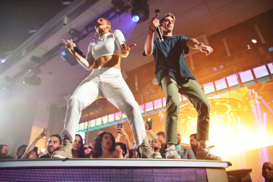 "Jennifer Lopez and Drew Taggart of The Chainsmokers are shown performing ""Dinero"" at XS Nightclub on Friday, June 1, 2018. (Danny Mahoney)"