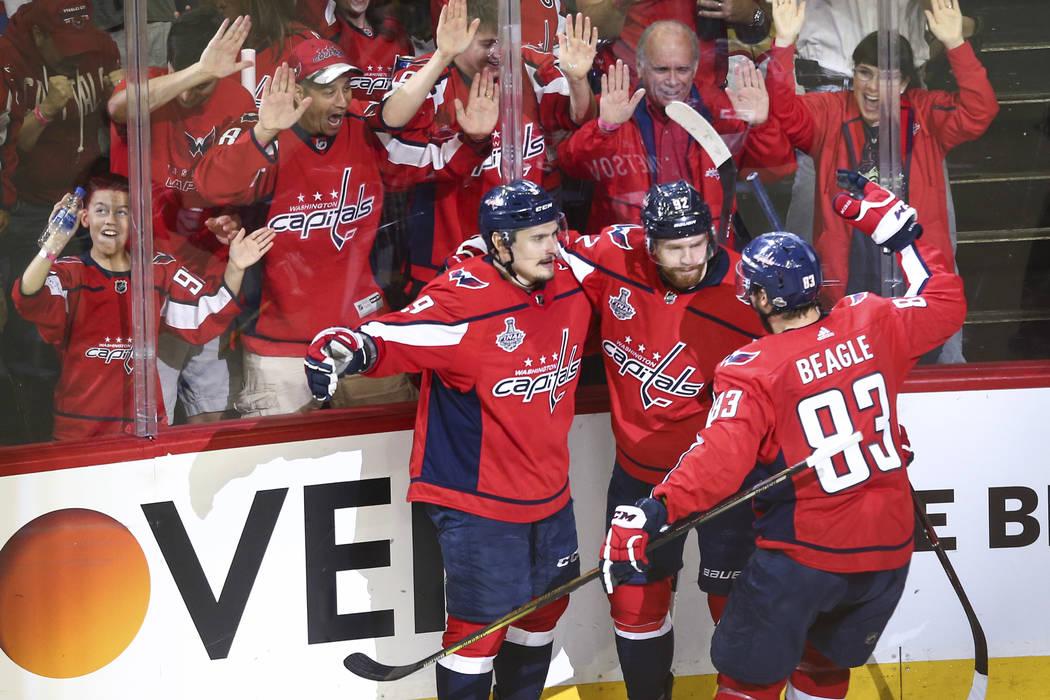 Washington Capitals center Evgeny Kuznetsov (92) celebrates his goal with defenseman Dmitry Orlov (9) and center Jay Beagle (83) during the second period of Game 3 of the NHL hockey Stanley Cup Fi ...