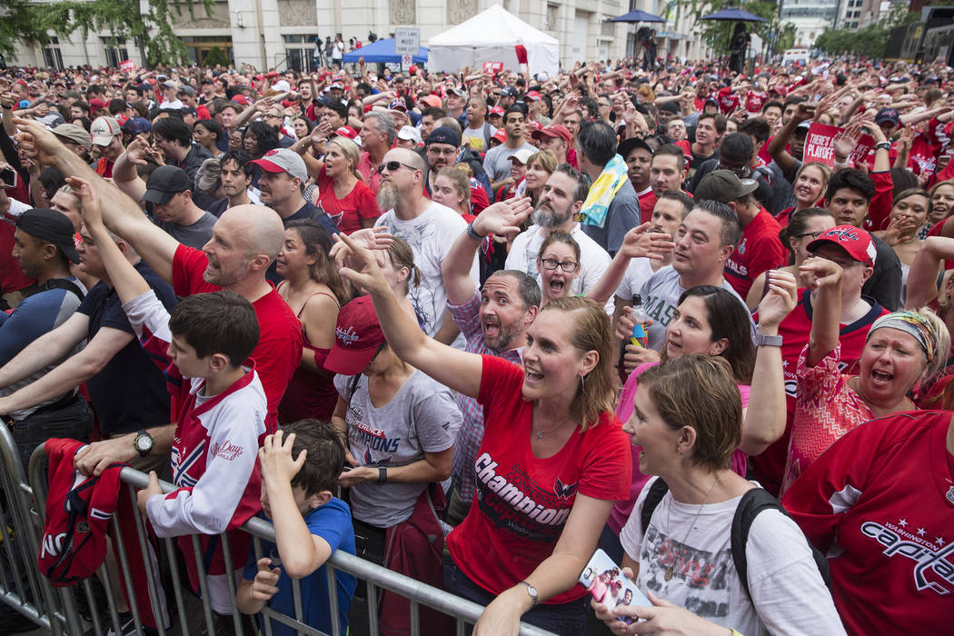 Capitals fans cheer for Sting and Shaggy outside Capital One Arena before the start of Game 3 of the NHL Stanley Cup Final with the Golden Knights and Washington Capitals on Saturday, June 2, 2018 ...