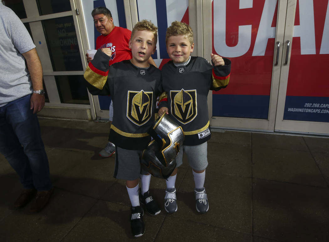 Golden Knights fans Walker Sventy, 8, left, and his brother Bear, 7, made the trek from Detroit for Game 3 of the NHL hockey Stanley Cup Final at Capital One Arena in Washington on Saturday, June ...