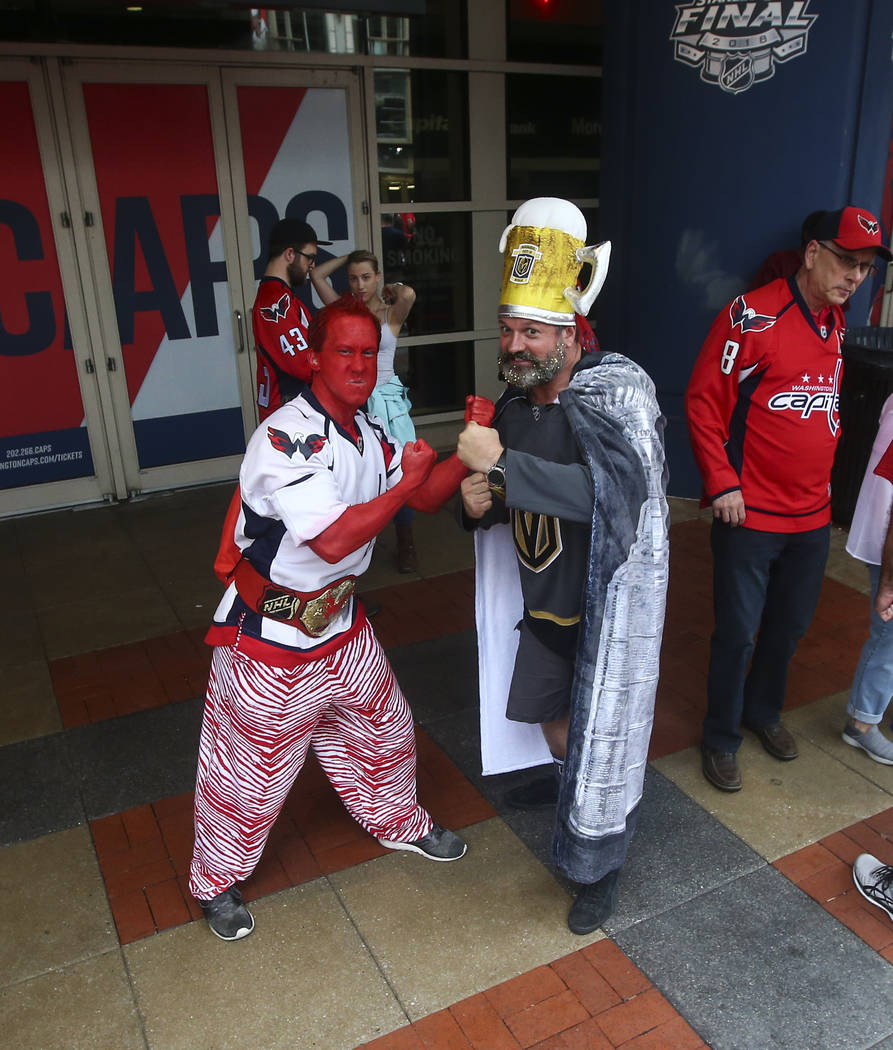 Golden Knights Zsolt Szorenyi, right, of Las Vegas poses with Washington Capitals fan Bob Gendler of Rockville, Md., before the start of Game 3 of the NHL hockey Stanley Cup Final at Capital One A ...