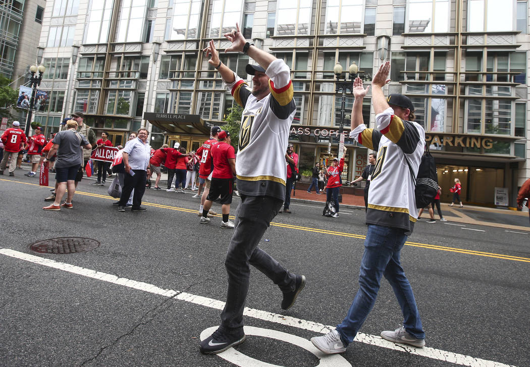 A pair of Golden Knights fans cheer before the start of Game 3 of the NHL hockey Stanley Cup Final at Capital One Arena in Washington on Saturday, June 2, 2018. Chase Stevens Las Vegas Review-Jour ...