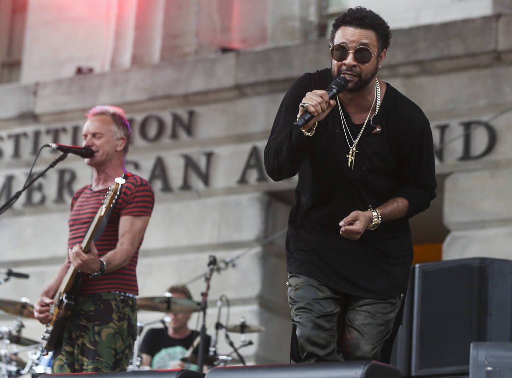 Shaggy, right, and Sting perform outside of the National Portrait Gallery before the start of Game 3 of the NHL hockey Stanley Cup Final at Capital One Arena in Washington on Saturday, June 2, 201 ...
