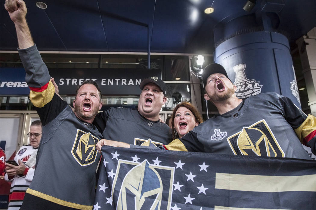 Golden Knights fan Tim Haughinberry, Frank Veilleux, and Mindy and Kevin Volcic cheer for Vegas outside Capital One Arena before the start of Game 3 of the NHL Stanley Cup Final with the Washingto ...