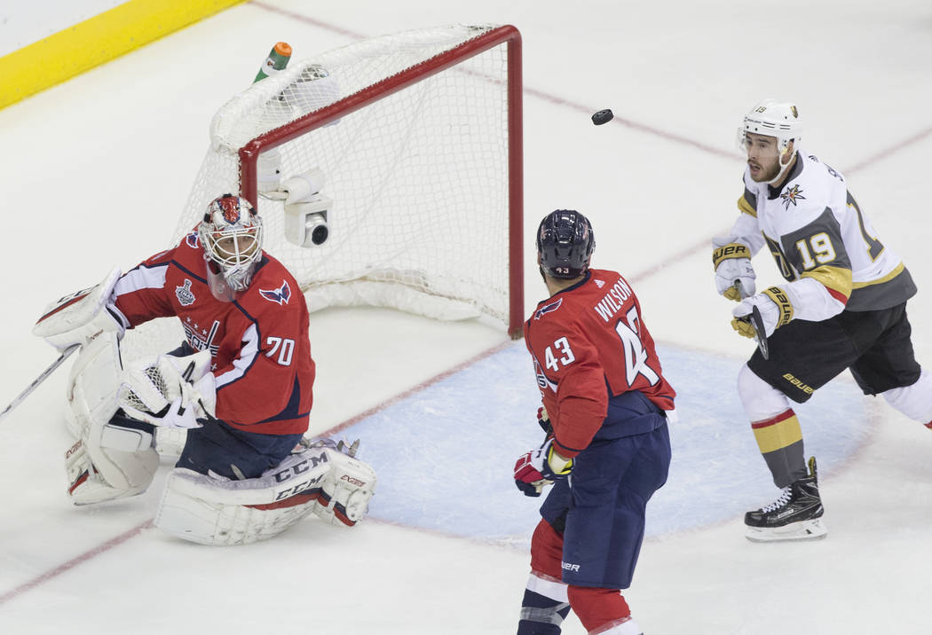 Capitals goaltender Braden Holtby (70) makes a first-period save against Golden Knights right wing Reilly Smith (19) during Game 3 of the NHL Stanley Cup Final on Saturday, June 2, 2018, at Capita ...