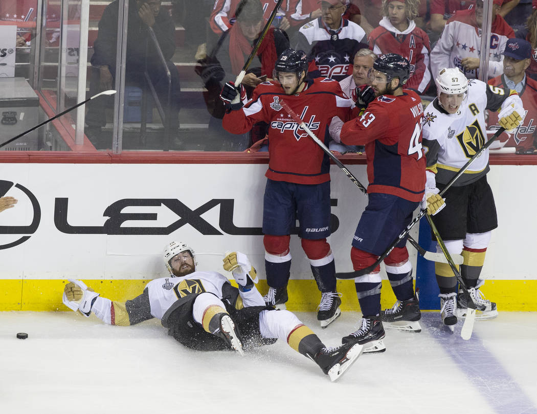 Golden Knights left wing James Neal (18) is knocked down by Capitals defenseman Christian Djoos (29) in the second period during Game 3 of the NHL Stanley Cup Final on Saturday, June 2, 2018, at C ...