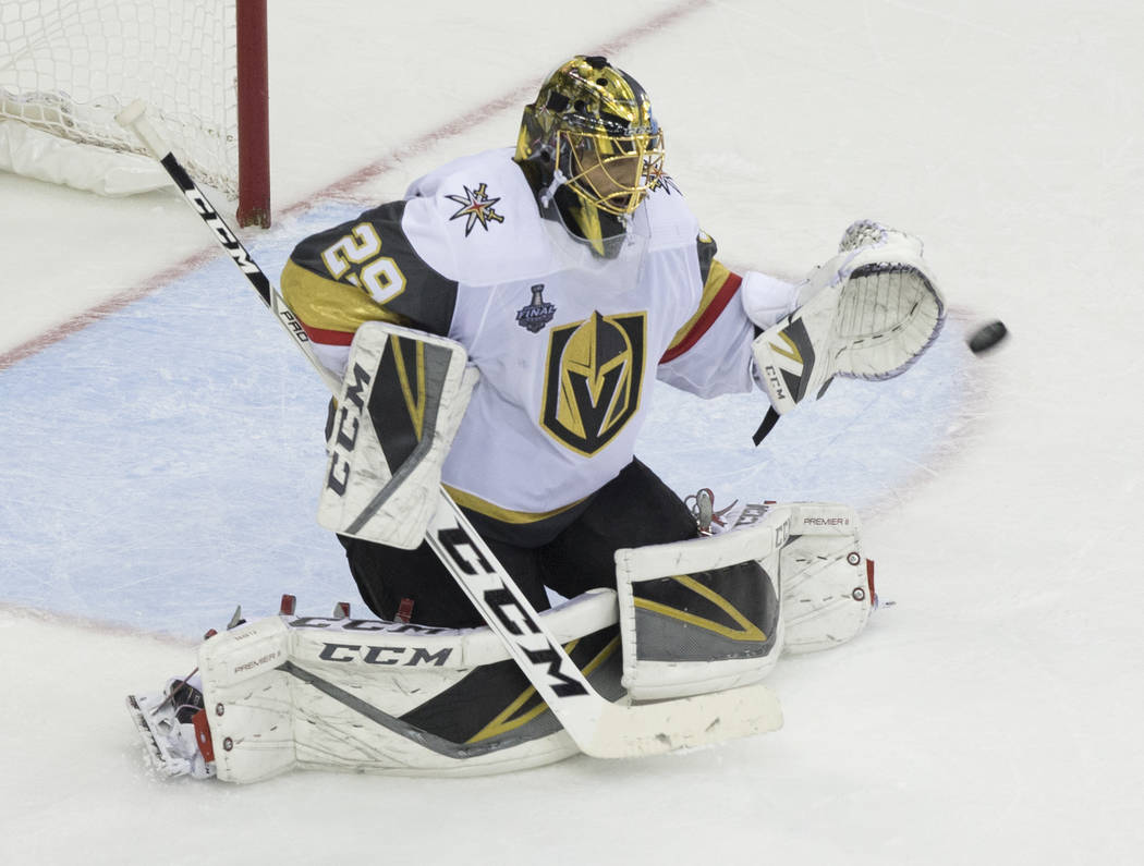 Golden Knights goaltender Marc-Andre Fleury (29) makes a save in the second period during Game 3 of the NHL Stanley Cup Final against the Washington Capitals on Saturday, June 2, 2018, at Capital ...