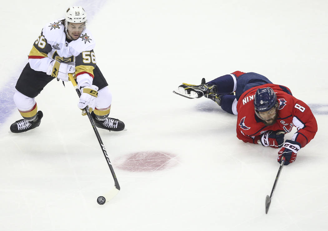 Golden Knights left wing Erik Haula (56) controls the puck as Washington Capitals left wing Alex Ovechkin (8) slips on the ice during the first period of Game 3 of the NHL hockey Stanley Cup Final ...