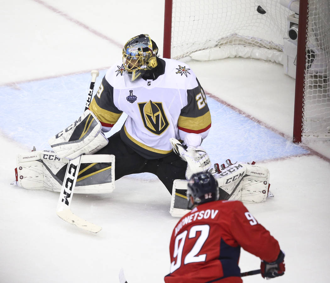 Washington Capitals center Evgeny Kuznetsov (92) scores past Golden Knights goaltender Marc-Andre Fleury (29) during the second period of Game 3 of the NHL hockey Stanley Cup Final at Capital One ...