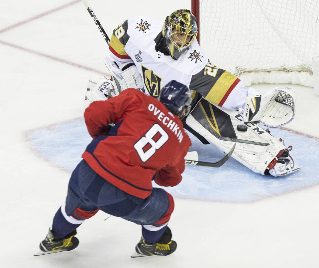 Golden Knights goaltender Marc-Andre Fleury (29) makes a save against Capitals left wing Alex Ovechkin (8) in the first period during Game 3 of the NHL Stanley Cup Final on Saturday, June 2, 2018, ...
