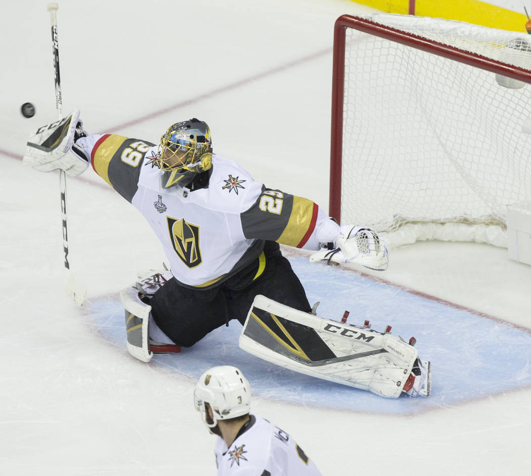 Golden Knights goaltender Marc-Andre Fleury (29) makes a save in the first period during Game 3 of the NHL Stanley Cup Final against the Washington Capitals on Saturday, June 2, 2018, at Capital O ...