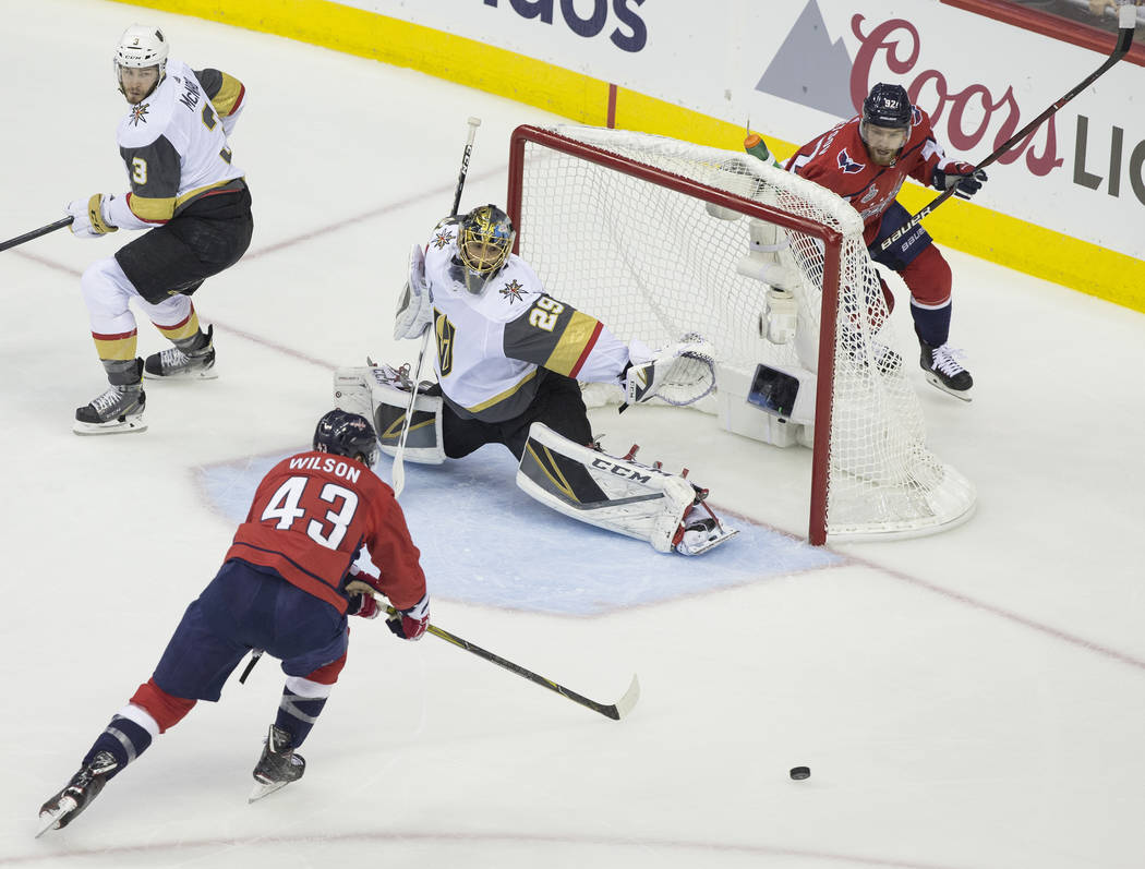 Golden Knights goaltender Marc-Andre Fleury (29) makes a save against Capitals right wing Tom Wilson (43) in the first period during Game 3 of the NHL Stanley Cup Final on Saturday, June 2, 2018, ...