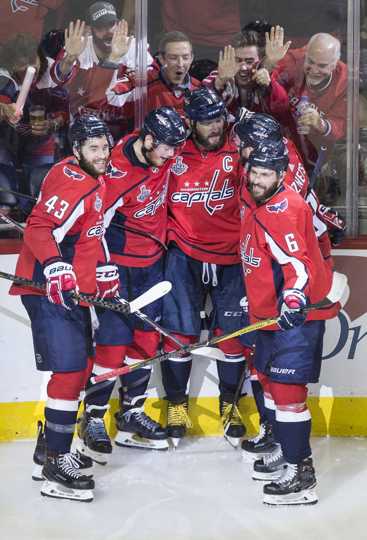 Capitals left wing Alex Ovechkin (8) celebrates with teammates after scoring a second-period goal during Game 3 of the NHL Stanley Cup Final against the Golden Knights on Saturday, June 2, 2018, a ...