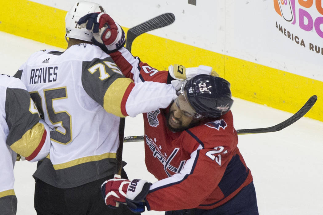 Capitals right wing Devante Smith-Pelly (25) punches Golden Knights right wing Ryan Reaves (75) in the second period during Game 3 of the NHL Stanley Cup Final on Saturday, June 2, 2018, at Capita ...