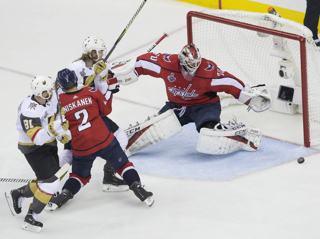 Capitals goaltender Braden Holtby (70) makes a second-period save during Game 3 of the NHL Stanley Cup Final against the Golden Knights on Saturday, June 2, 2018, at Capital One Arena, in Washingt ...