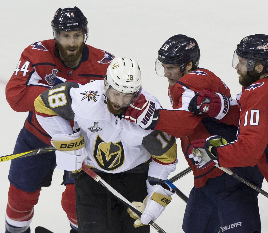 Golden Knights left wing James Neal (18) gets punched by Capitals defenseman Christian Djoos (29) in the second period during Game 3 of the NHL Stanley Cup Final on Saturday, June 2, 2018, at Capi ...