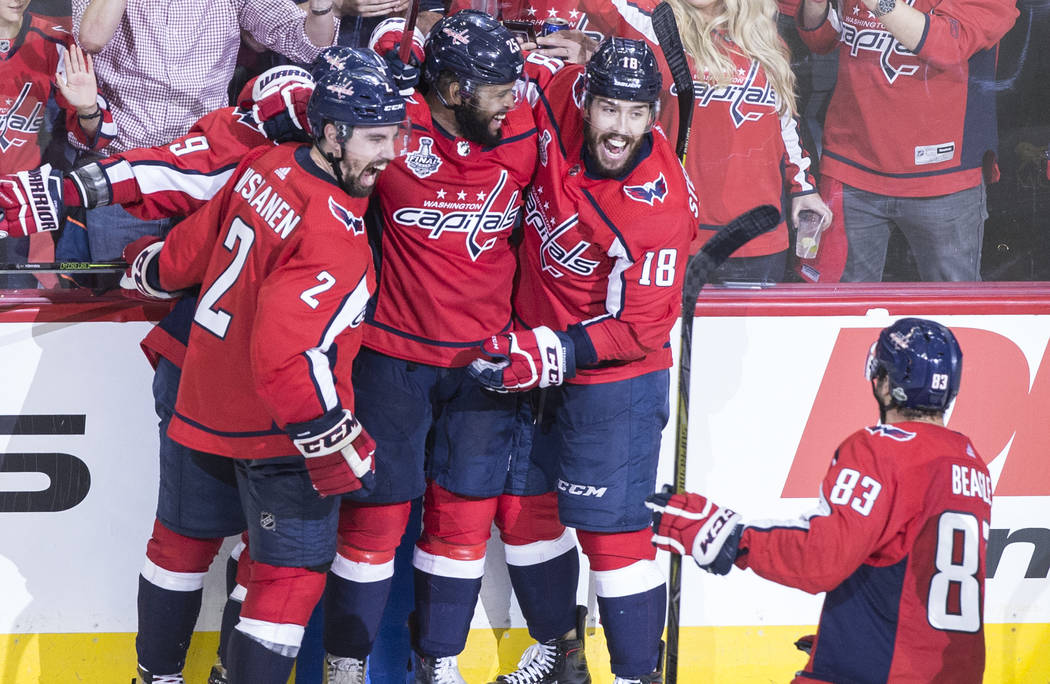 Capitals defenseman Matt Niskanen (2), right wing Devante Smith-Pelly (25), center Chandler Stephenson (18) and right wing Jay Beagle (83) celebrate after Smith-Pelly scored a third-period goal du ...