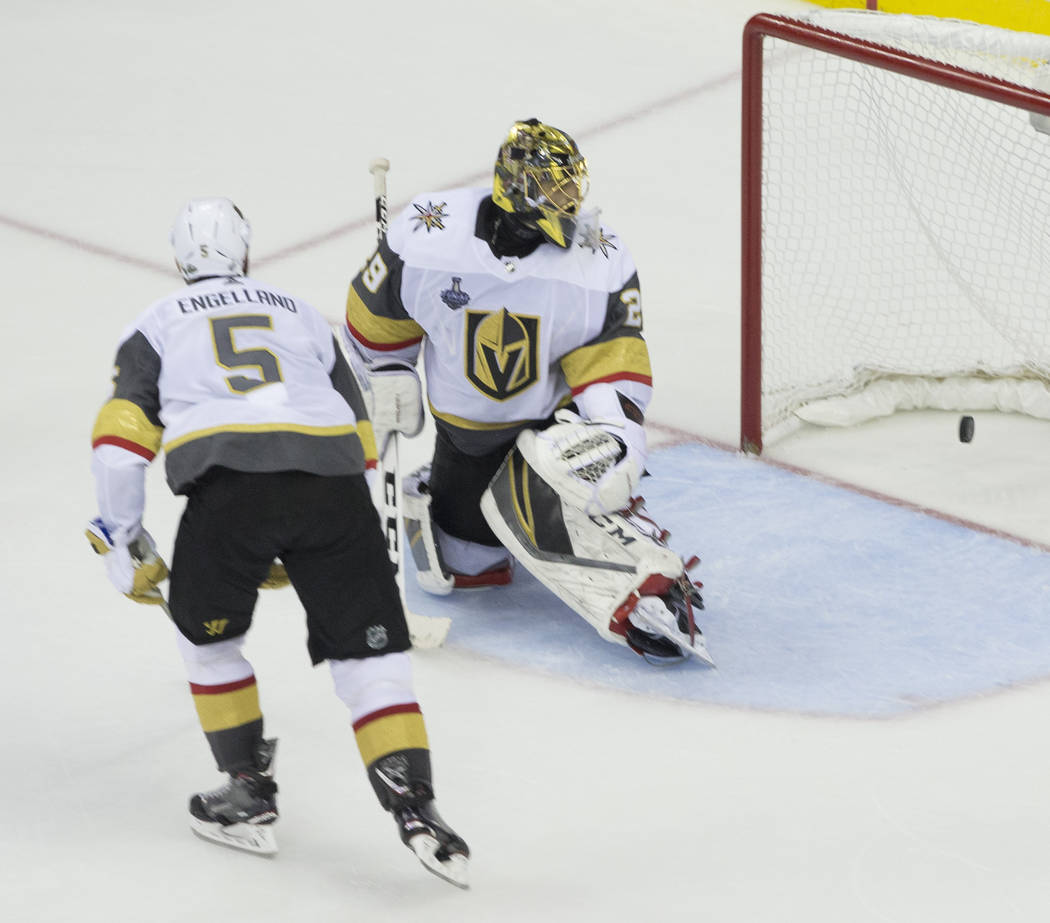 Golden Knights goaltender Marc-Andre Fleury (29) allows a third-period goal by Capitals right wing Devante Smith-Pelly (25) during Game 3 of the NHL Stanley Cup Final on Saturday, June 2, 2018, at ...