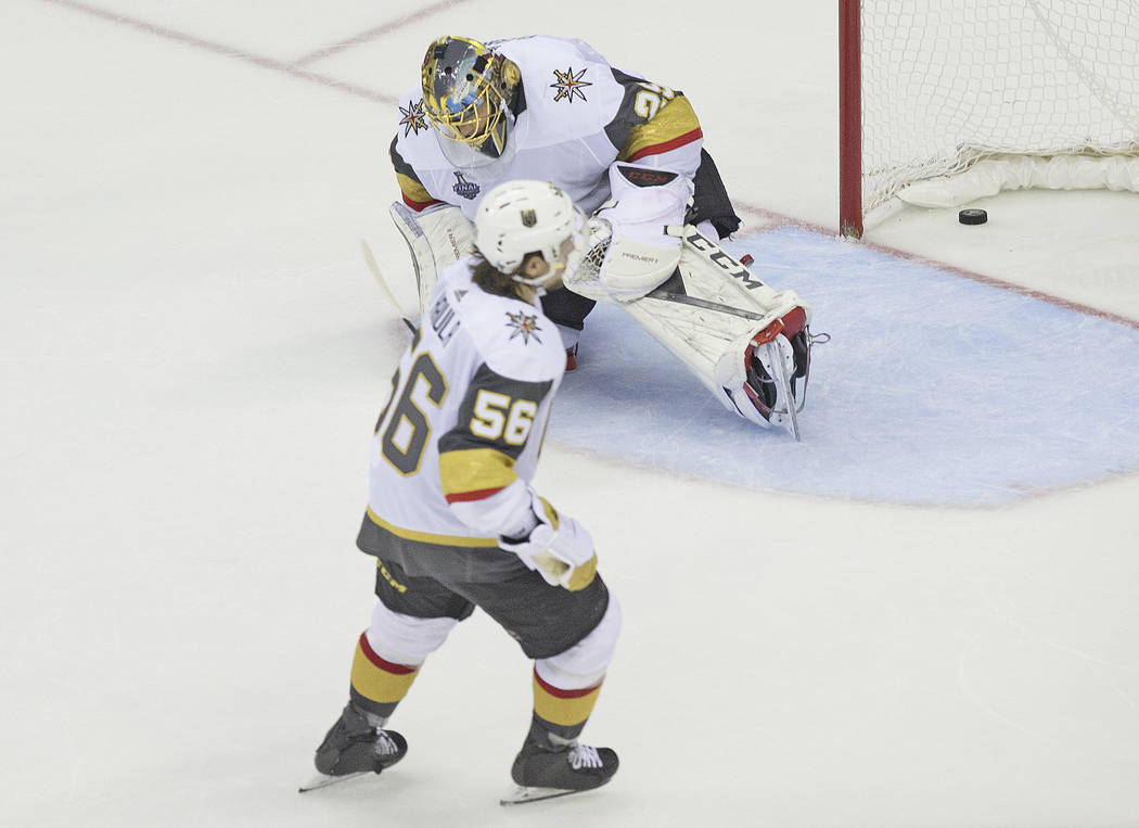 Golden Knights goaltender Marc-Andre Fleury (29) allows a third-period goal by Capitals right wing Devante Smith-Pelly (25) as Golden Knights left wing Erik Haula (56) looks on during Game 3 of th ...