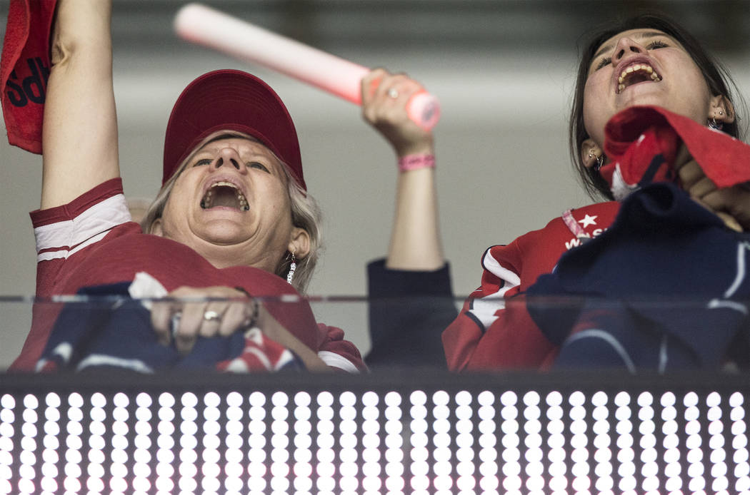 Washington fans cheer for the Capitals during the third period of Game 3 of the NHL Stanley Cup Final with the Golden Knights on Saturday, June 2, 2018, at Capital One Arena, in Washington. The Ca ...