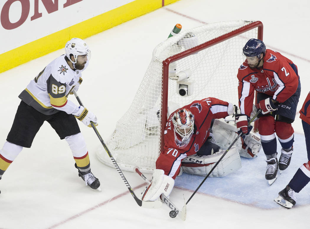 Capitals goaltender Braden Holtby (70) makes a third-period save against Golden Knights right wing Alex Tuch (89) during Game 3 of the NHL Stanley Cup Final on Saturday, June 2, 2018, at Capital O ...