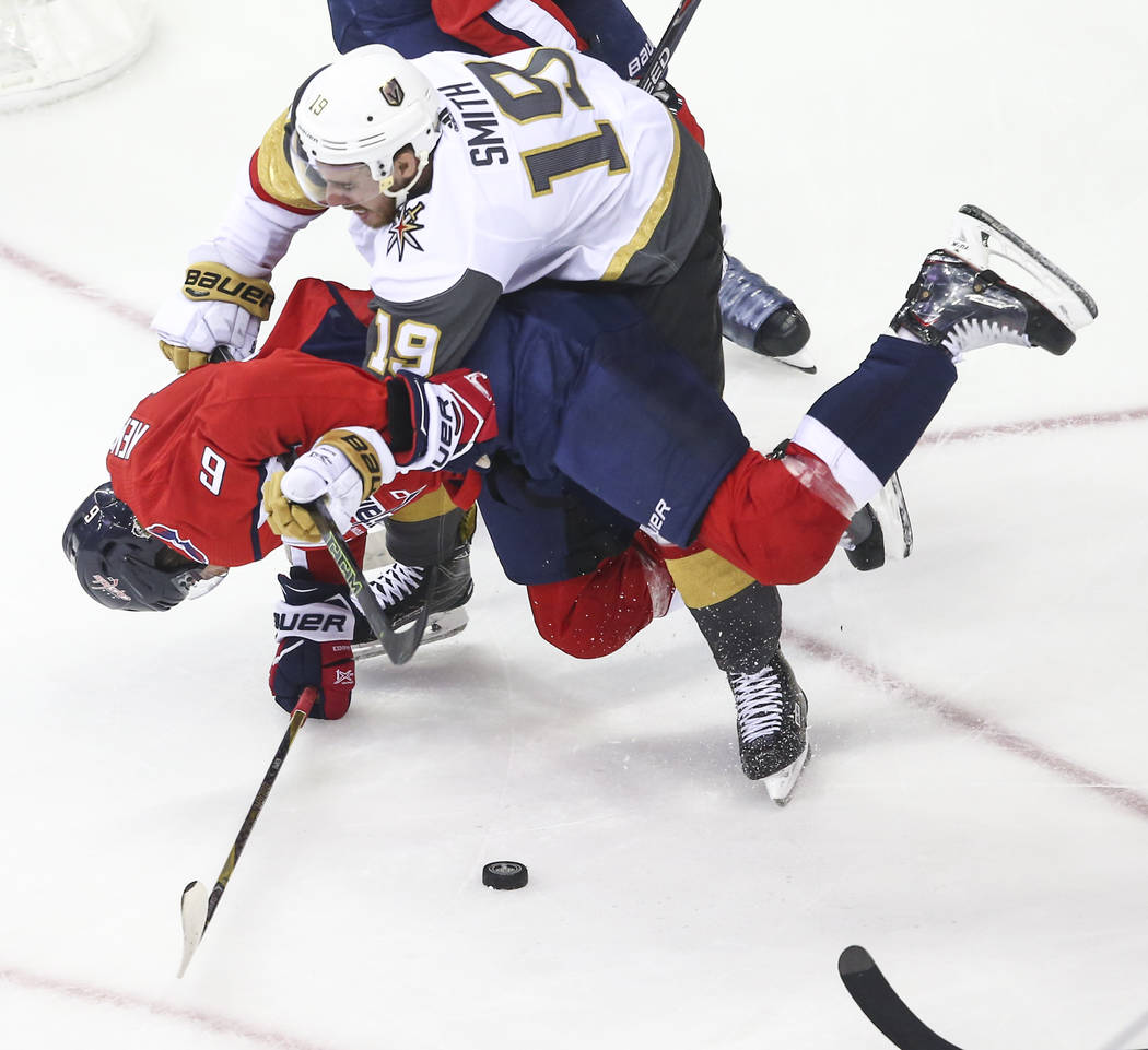 Golden Knights right wing Reilly Smith (19) knocks down Washington Capitals defenseman Michal Kempny (6) during the first period of Game 3 of the NHL hockey Stanley Cup Final at Capital One Arena ...