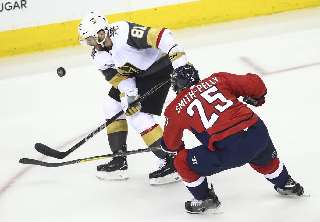 Golden Knights center Jonathan Marchessault (81) and Washington Capitals right wing Devante Smith-Pelly (25) battle for the puck during the first period of Game 3 of the NHL hockey Stanley Cup Fin ...