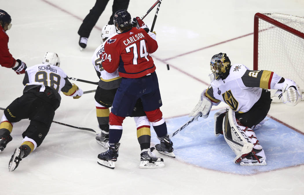 Washington Capitals left wing Alex Ovechkin, on the far left, scores a goal past Golden Knights goaltender Marc-Andre Fleury (29) during the second period of Game 3 of the NHL hockey Stanley Cup F ...
