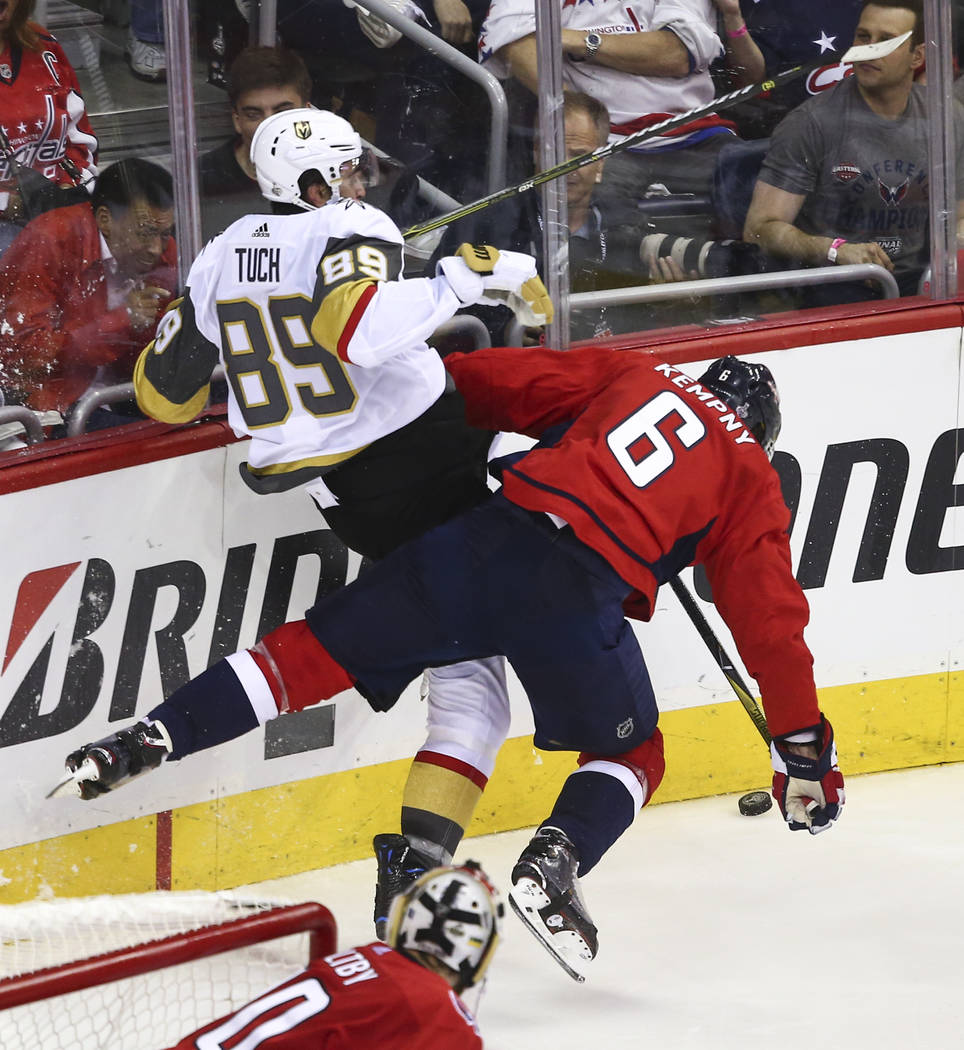 Golden Knights right wing Alex Tuch (89) gets checked by Washington Capitals defenseman Michal Kempny (6) during the second period of Game 3 of the NHL hockey Stanley Cup Final at Capital One Aren ...