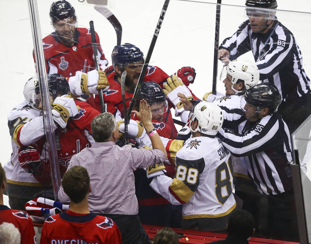 Golden Knights defenseman Nate Schmidt (88) gets into a fight with Washington Capitals defenseman Christian Djoos (29) during the second period of Game 3 of the NHL hockey Stanley Cup Final at Cap ...