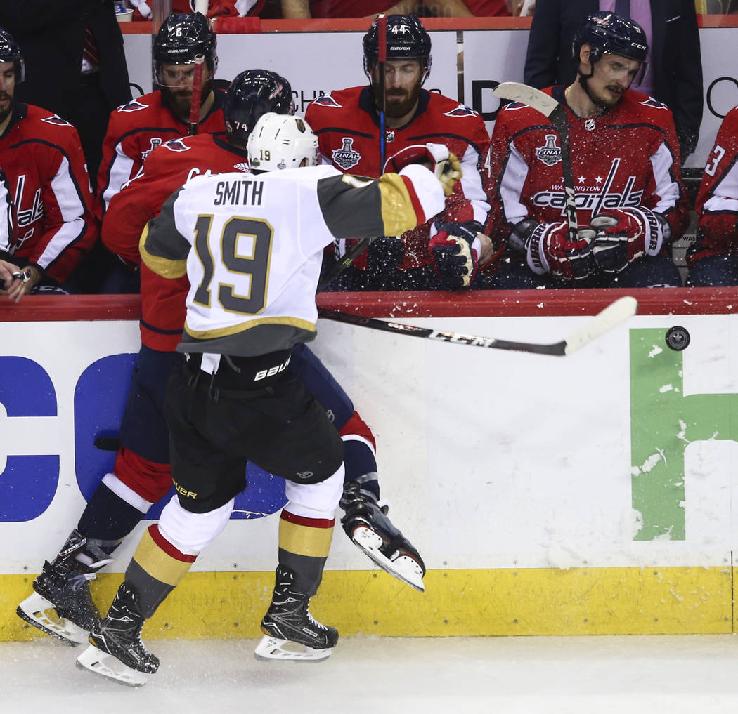 Washington Capitals defenseman John Carlson (74) gets checked by Golden Knights right wing Reilly Smith (19) during the second period of Game 3 of the NHL hockey Stanley Cup Final at Capital One A ...