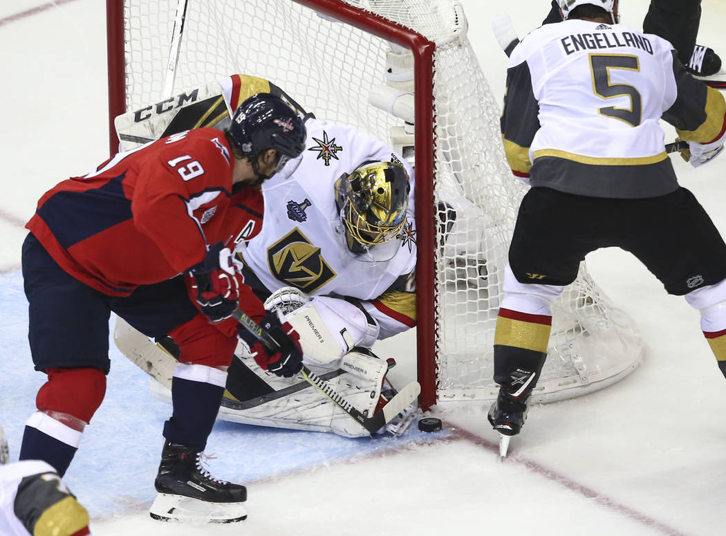 Golden Knights goaltender Marc-Andre Fleury (29) defends the net as Washington Capitals center Nicklas Backstrom (19) attempts to score during the second period of Game 3 of the NHL hockey Stanley ...