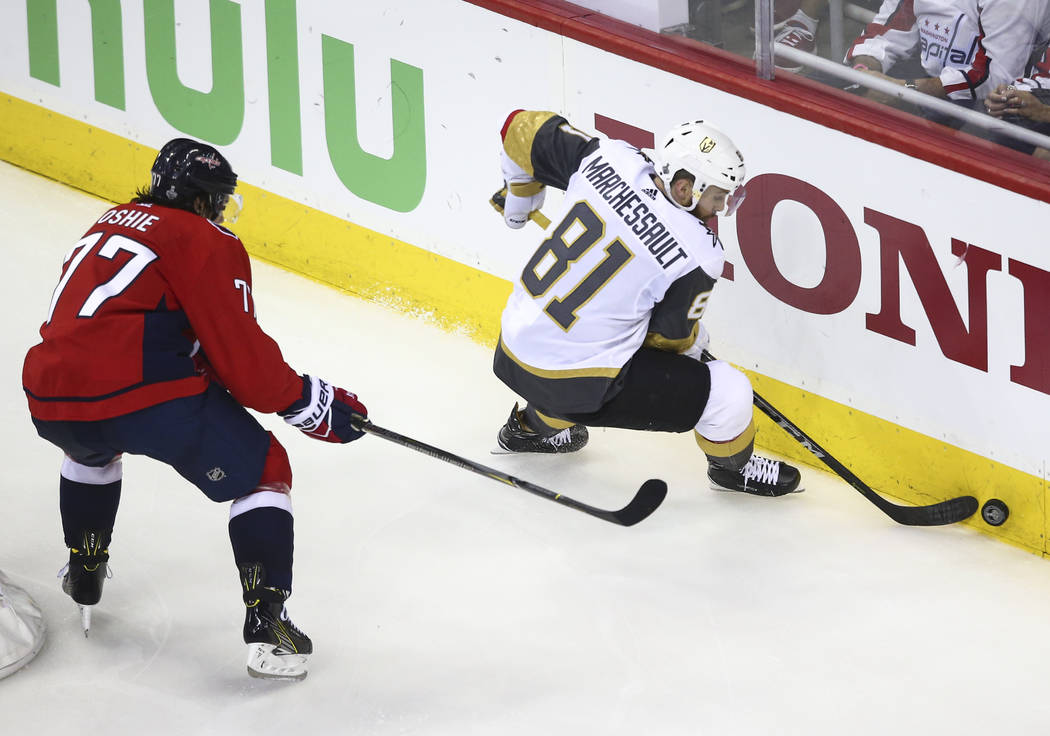 Golden Knights center Jonathan Marchessault (81) moves the puck in front of Washington Capitals right wing T.J. Oshie (77) during the third period of Game 3 of the NHL hockey Stanley Cup Final at ...