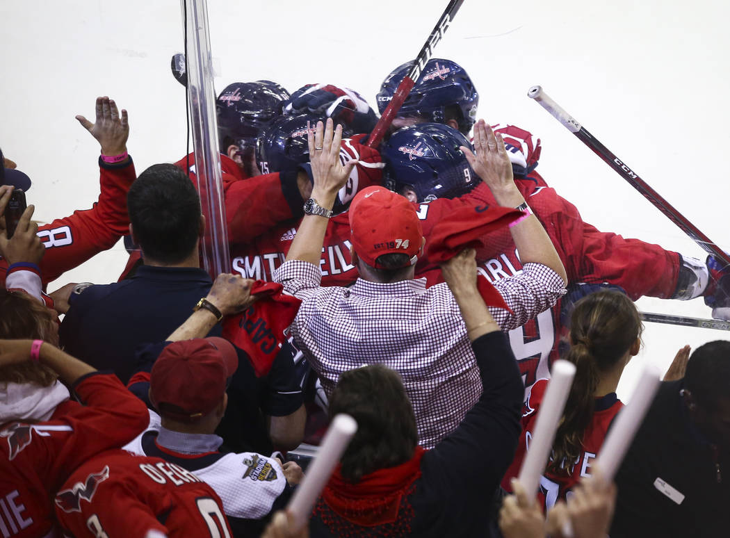 Washington Capitals players celebrate a goal by right wing Devante Smith-Pelly during the third period of Game 3 of the NHL hockey Stanley Cup Final against the Golden Knights at Capital One Arena ...