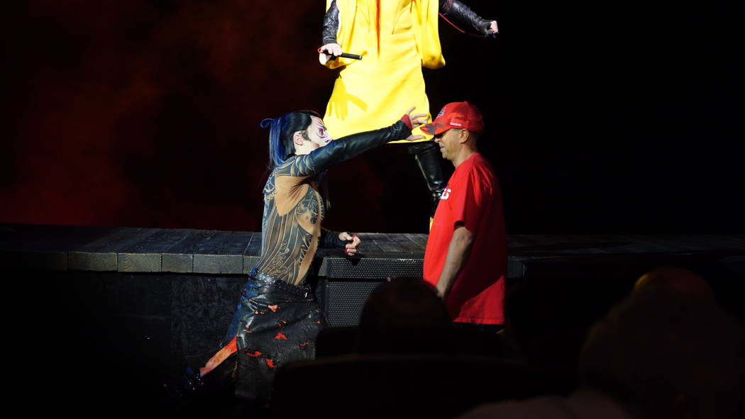 """A scene from """"Ka"""" at MGM Grand, in which an audience member played by a Cirque artist wearing a Washington Capitals hat is about to be tossed over the side of the stage. (Cirque du Soliel)"""