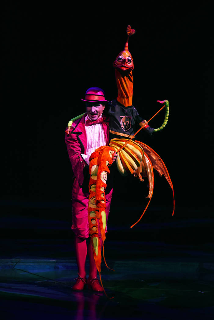 """The bird-like puppet from """"Mystere"""" at Treasure Island, operated by the character Moha-Samedi wears a Golden Knights jersey during the show on Wednesday, May 30, 2018. (Cirque du Soleil)"""