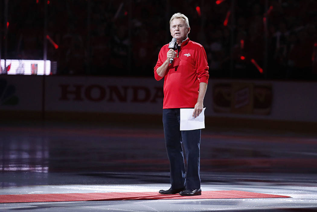 Entertainer Pat Sajak, a Washington Capitals season ticket holder, introduces the players for the Capitals and the Vegas Golden Knights before Game 3 of the NHL hockey Stanley Cup Final, Saturday, ...