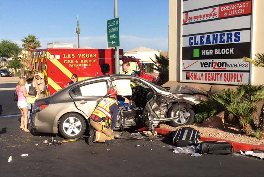 Crews work the scene of a fatal two-vehicle crash near West Charleston and North Rainbow boulevards in Las Vegas on Saturday. (Las Vegas Fire & Rescue via Twitter)