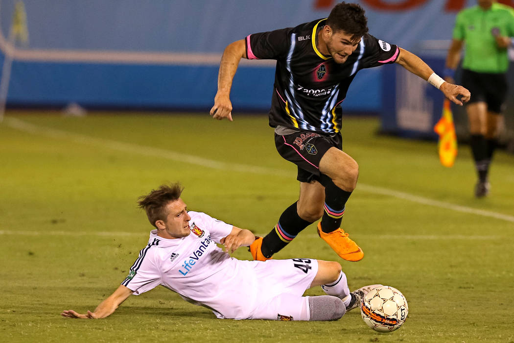 Las Vegas Lights FC midfielder/forward Matt Thomas (21) breaks away from Real Monarchs defender Andrew Brody (45) during a United Soccer League game at Cashman Field in Las Vegas on Saturday, May ...